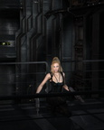 Blonde Sci-fi Heroine Crouching in a Dark City Street